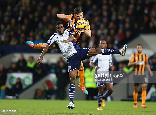 Alex Bruce of Hull City jumps with Brown Ideye of West Bromwich Albion during the Barclays Premier League match between West Bromwich Albion and Hull...