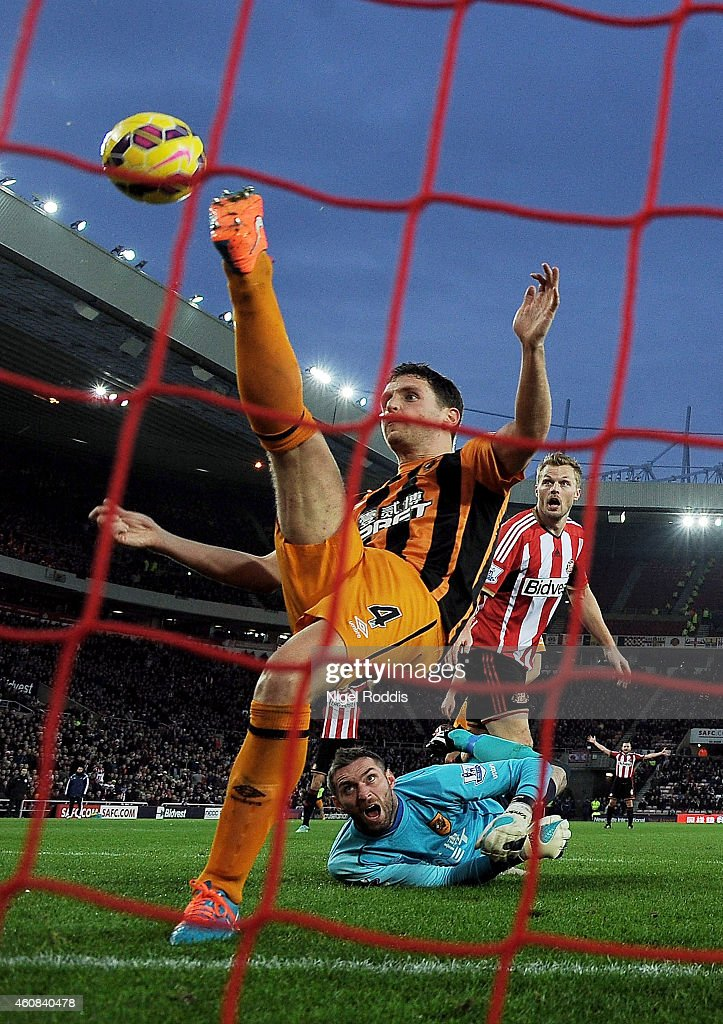 Alex Bruce of Hull City makes a goal line clearance during the Barclays Premier League match between Sunderland and Hull City at the Stadium of Light on December 26, 2014 in Sunderland, England.
