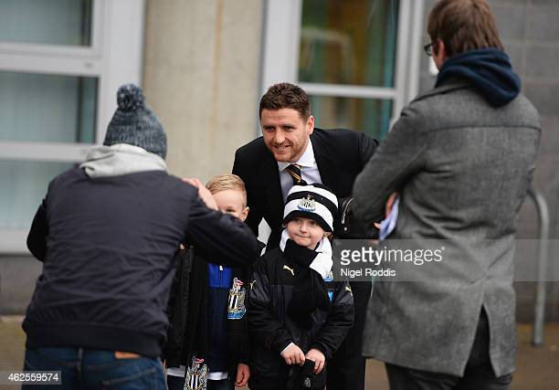 Alex Bruce of Hull City poses for a photo with Newcastle fans prior to the Barclays Premier League match between Hull City and Newcastle United at KC...