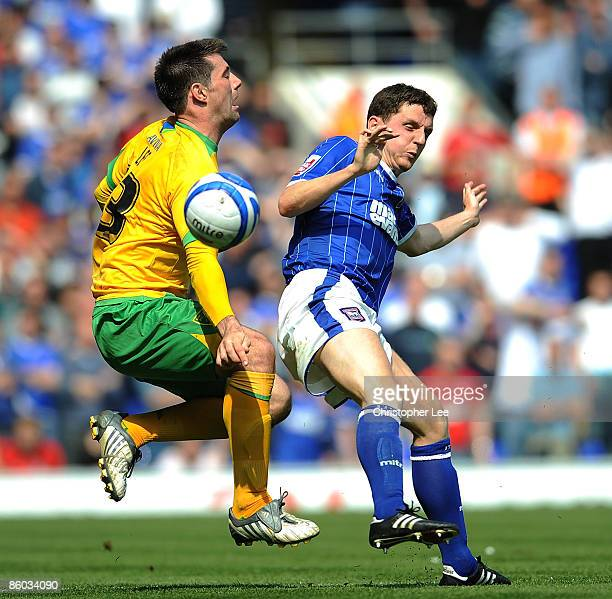 Alex Bruce of Ipswich tackles Alan Lee of Norwich during the CocaCola Championship match between Ipswich Town and Norwich City at Portman Road on...