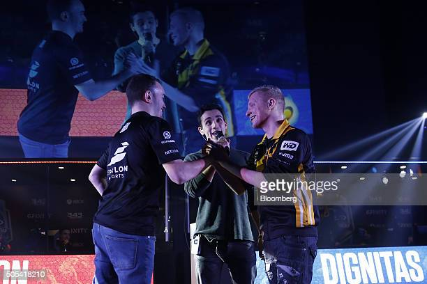 Alex Buck also known as BUK 20 of team Epsilon eSports left shakes hands with Scott Findlay also known as Fuzion of Team Dignitas right ahead of...