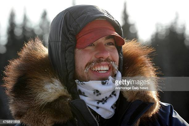 Alex Buetow is all smiles as he arrives at the Nikolai checkpoint during the 2014 Iditarod Trail Sled Dog Race on Wednesday March 5 in Alaska