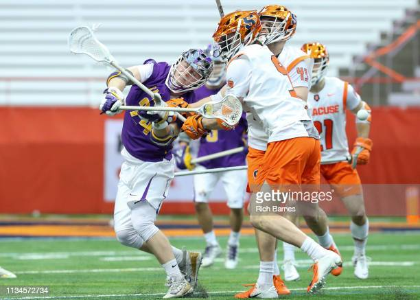 Alex Burgmaster of the Albany Great Danes loses control of the ball on a check by Peter Dearth of the Syracuse Orange during the first half at the...