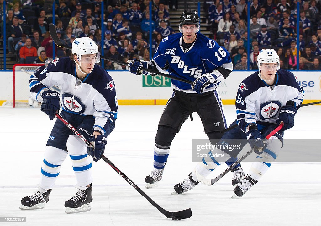 Alex Burmistrov #8 of the Winnipeg Jets controls the puck during the second period of the game against the Winnipeg Jets at the Tampa Bay Times Forum on February 1, 2013 in Tampa, Florida.