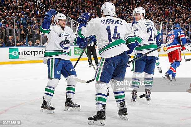 Alex Burrows Ben Hutton and Linden Vey of the Vancouver Canucks celebrate after a goal in the second period against the New York Rangers at Madison...