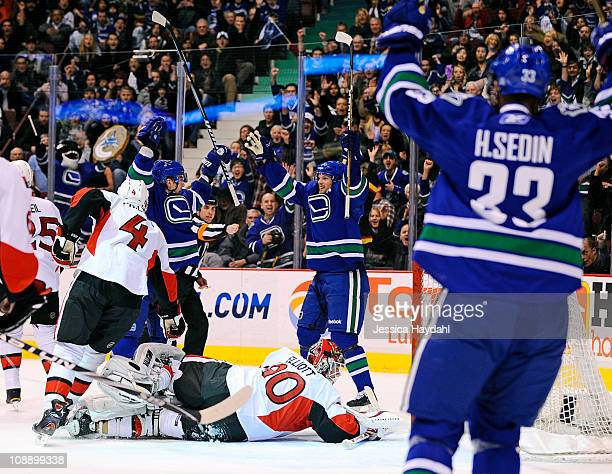 Alex Burrows Daniel Sedin and Daniel Sedin of the Vancouver Canucks celebrate a first period goal while Brian Elliott and Chris Phillips of the...