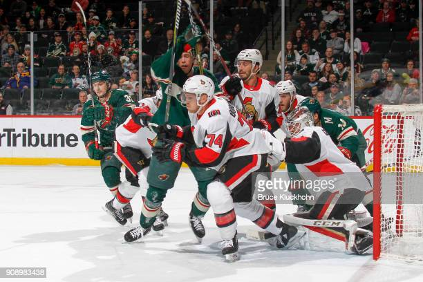 Alex Burrows Mark Borowiecki Gabriel Dumont Fredrik Claesson and Mike Condon of the Ottawa Senators defend their goal against Kyle Rau Charlie Coyle...
