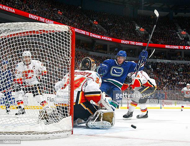 Alex Burrows of the Vancouver Canucks celebrates a firstperiod goal on Miikka Kiprusoff of the Calgary Flames during their game at Rogers Arena on...