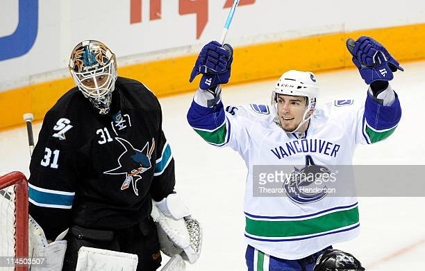 Alex Burrows of the Vancouver Canucks celebrates after scoring in the third period as goaltender Antti Niemi of the San Jose Sharks looks on in Game...