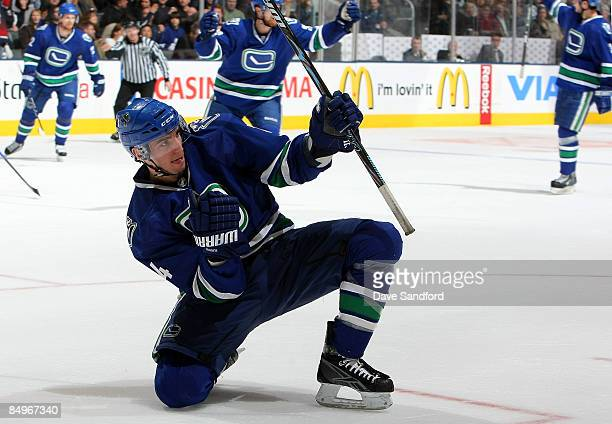 Alex Burrows of the Vancouver Canucks celebrates his tying goal against the Toronto Maple Leafs during their NHL game at the Air Canada Centre...