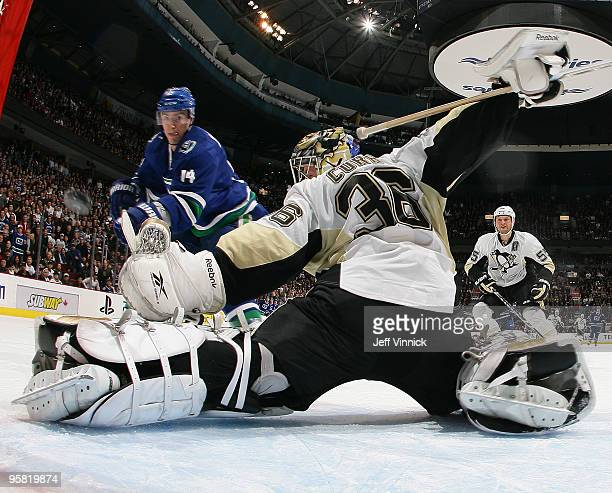 Alex Burrows of the Vancouver Canucks scores on a backhand shot past John Curry of the Pittsburgh Penguins during their game at General Motors Place...