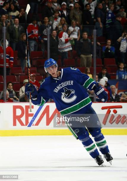 Alex Burrows of the Vancouver Canucks waves to fans after being named a star during their game against the Montreal Canadiens at General Motors Place...