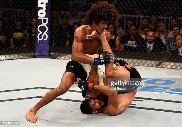 Alex Caceres controls the body of Yair Rodriguez of Mexico in their featherweight bout during the UFC Fight Night event at Vivint Smart Home Arena on...