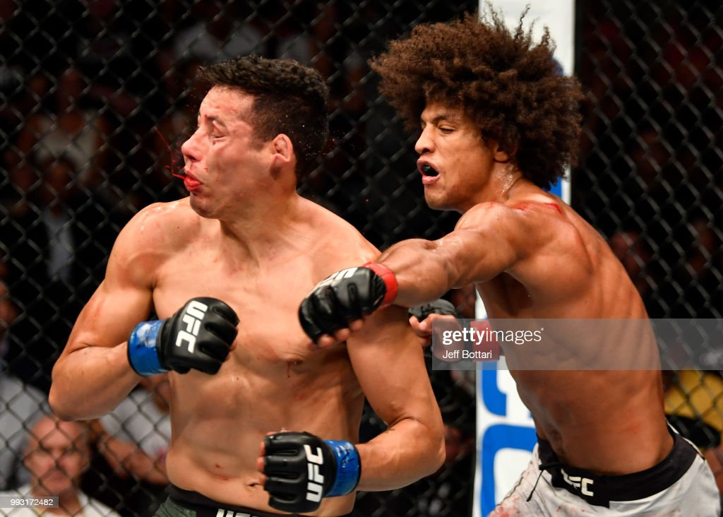 Alex Caceres punches Martin Bravo of Mexico in their featherweight bout during The Ultimate Fighter Finale event inside The Pearl concert theater at Palms Casino Resort on July 6, 2018 in Las Vegas, Nevada.