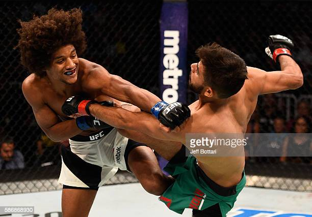 Alex Caceres punches Yair Rodriguez of Mexico in their featherweight bout during the UFC Fight Night event at Vivint Smart Home Arena on August 6...
