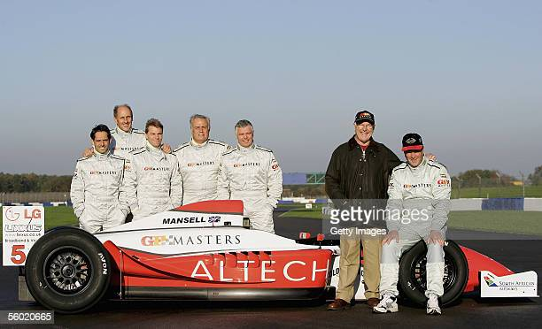 Alex Caffi Hans Stuck Patrick Tambay and Derek Warwick pose with Murray Walker and Nigel Mansell during testing for the Grand Prix Masters Series at...