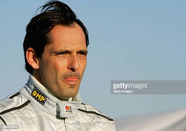 Alex Caffi of Italy looks down the pit lane during testing for the Grand Prix Masters Series at Silverstone Circuit on October 27 2005 in Silverstone...