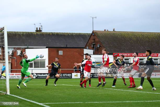 Alex Cairns of Fleetwood Town saves from Matt Sadler of Shrewsbury Town during the Sky Bet League One match between Fleetwood Town and Shrewsbury...
