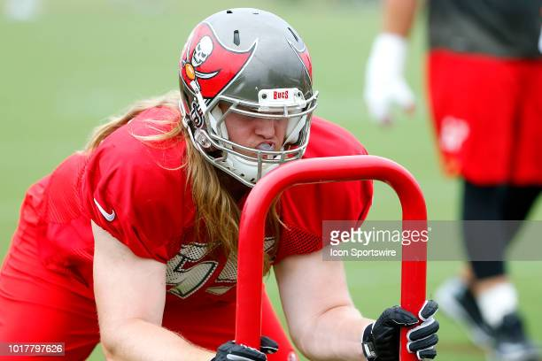 Alex Cappa of the Bucs pushes the sled during the joint training camp work out between the Tampa Bay Buccaneers and the Tennessee Titans on August 16...