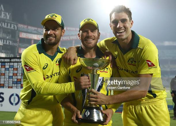 Alex Carey Aaron Finch and Pat Cummins of Australia pose with the ODI Trophy after Australia defeated India during game five of the One Day...