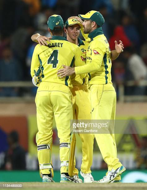 Alex Carey Adam Zampa and Glenn Maxwell of Australia celebrate after Australia defeated India during game three of the One Day International series...