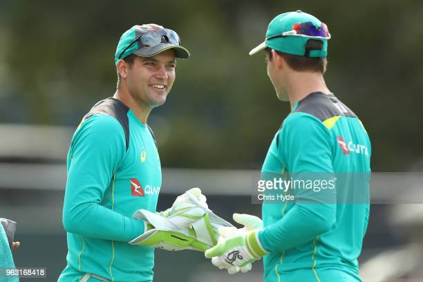 Alex Carey and Tim Paine talk during an Australian ODI training session at Allan Border Field on May 28 2018 in Brisbane Australia