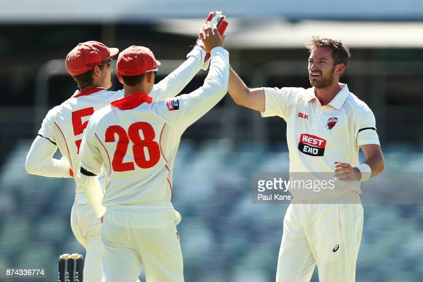Alex Carey Jake Weatherald and Chadd Sayers of South Australia celebrate the wicket of Ashton Turner of Western Australia during day three of the...