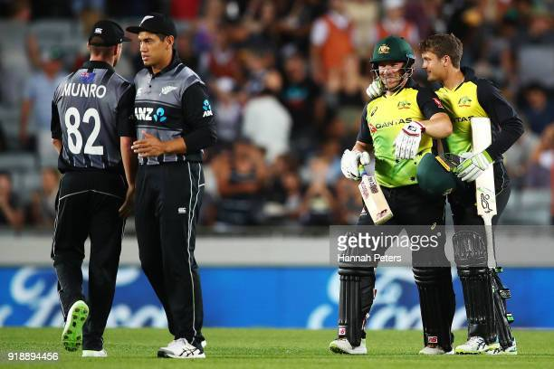Alex Carey of Australia and Aaron Finch of Australia celebrate after winning the International Twenty20 match between New Zealand and Australia at...