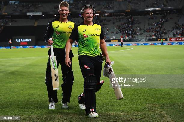Alex Carey of Australia and Aaron Finch of Australia walk off after beating the International Twenty20 match between New Zealand and Australia at...