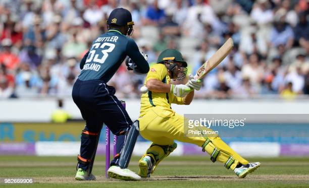 Alex Carey of Australia attempts a ramp shot as Jos Buttler of England looks on during the fifth Royal London OneDay International match between...