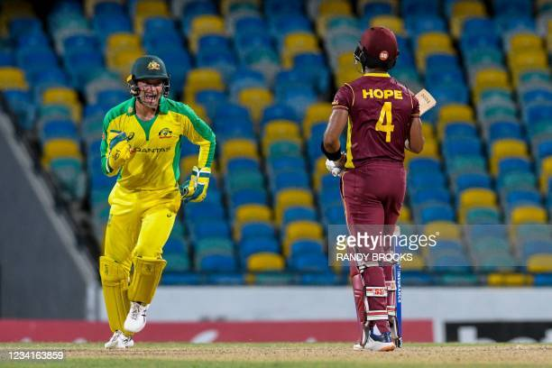 Alex Carey of Australia celebrates the dismissal of Shai Hope of West Indies during the 2nd ODI between West Indies and Australia at Kensington Oval,...