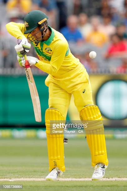Alex Carey of Australia edges the ball to be caught by Virat Kohli of India during game three of the One Day International series between Australia...