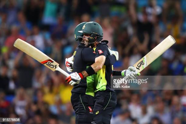 Alex Carey of Australia embraces Glenn Maxwell of Australia as he celebrates his century during the Twenty20 International match between Australia...