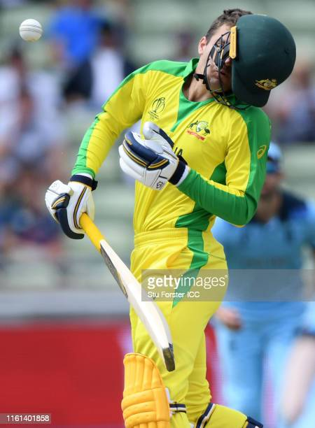 Alex Carey of Australia has his helmet knocked off by a bouncer from Jofra Archer of England during the SemiFinal match of the ICC Cricket World Cup...