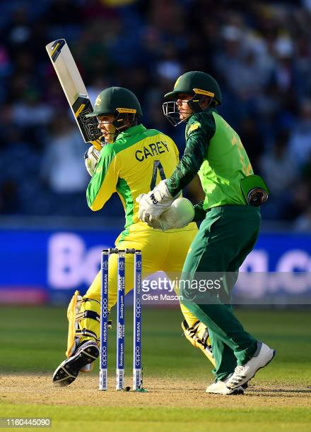 Alex Carey of Australia in action batting as Quinton de Kock of South Africa looks on during the Group Stage match of the ICC Cricket World Cup 2019...