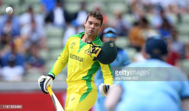 Alex Carey of Australia is hit by a bouncer from Jofra Archer of England during the SemiFinal match of the ICC Cricket World Cup 2019 between...