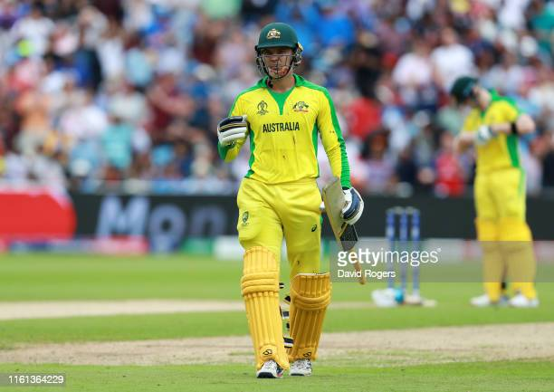 Alex Carey of Australia leaves the field dejected after being caught on the boundary by James Vince of England during the SemiFinal match of the ICC...