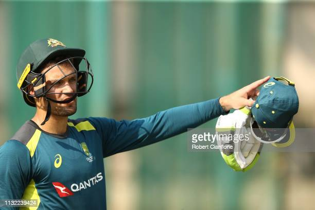 Alex Carey of Australia looks on during the Australian training session ahead of game two of the T20I Series between India and Australia at M...
