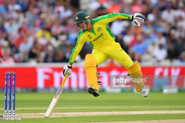 Alex Carey of Australia makes his ground as the ball is thrown at the stumps during the SemiFinal match of the ICC Cricket World Cup 2019 between...