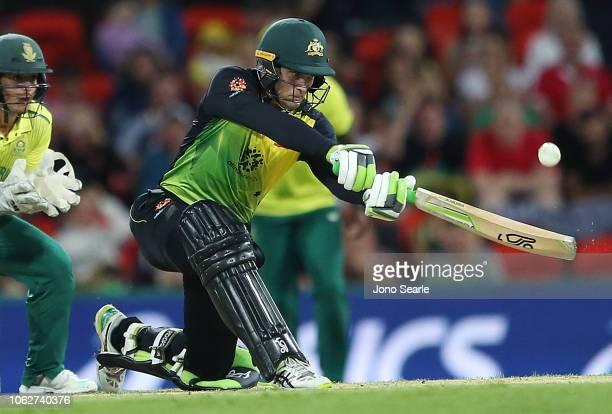 Alex Carey of Australia plays a shot during the International Twenty20 match between Australia and South Africa at Metricon Stadium on November 17...