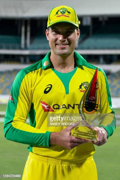 Alex Carey of Australia poses for a photo with the trophy after winning the 3rd and final ODI between West Indies and Australia at Kensington Oval,...