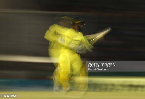 Alex Carey of Australia runs during game four of the One Day International series between India and Australia at Punjab Cricket Association Stadium...