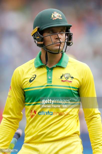 Alex Carey of Australia walks from the field after being dismissed during game three of the One Day International series between Australia and India...