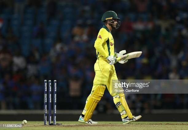 Alex Carey of Australia walks off after he was bowled by Kuldeep Yadav of India during game two of the One Day International series between India and...