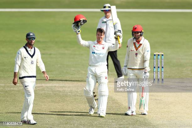 Alex Carey of South Australia celebrates reaching a century during day three of the Sheffield Shield match between Victoria and South Australia at...
