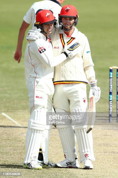 Alex Carey of South Australia is congratulated by Tom Cooper of South Australia on reaching his century during day three of the Sheffield Shield...