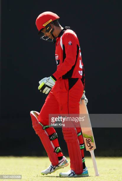 Alex Carey of South Australia walks from the field after being dismissed during the JLT One Day Cup match between South Australia and Tasmania at...