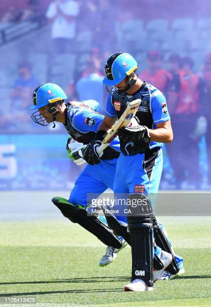 Alex Carey of the Adelaide Strikers and Jake Weatherald of the Adelaide Strikers head out to bat during the Adelaide Strikers v Perth Scorchers Big...