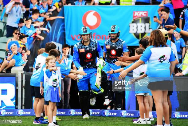 Alex Carey of the Adelaide Strikers and Jake Weatherald of the Adelaide Strikers runonto the field to bat during the Big Bash League match between...