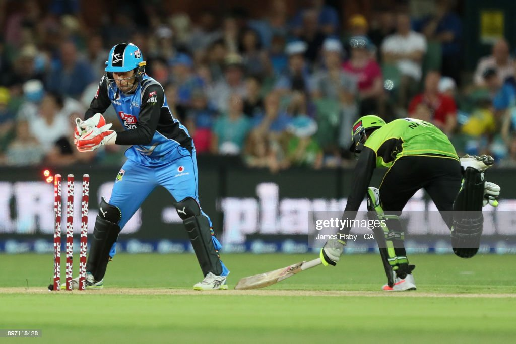 Alex Carey of the Adelaide Strikers attempts a runout of Kurtis Patterson of the Sydney Thunder during the Big Bash League match between the Adelaide Strikers and the Sydney Thunder at Adelaide Oval on December 22, 2017 in Adelaide, Australia.
